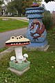 Sid Boyum Man-Eating Mushroom and Blue Urn with Dragon in Jackson Square in Madison, Wisconsin.jpg