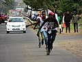 Skaters skating on a busy road.jpg