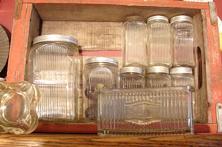Color picture of old kitchen glassware in a wooden cabinet