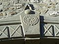 Sole delle Alpi inciso su pietra in un antico archivolto nella Valdenza.jpg