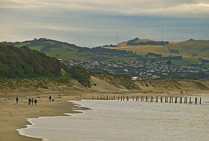 Sand fence - A local landmark in Dunedin, New Zealand — the St. Clair Beach posts are the remains of a series of sandbreaks, originally linked by boards to catch the blown sand.