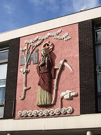 Saint Sidwell - The relief of Saint Sidwell on a shopping arcade in Sidwell Street, Exeter.