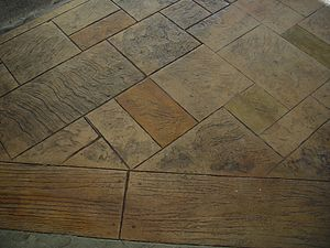 Decorative concrete - Stamped Concrete in various patterns, highlighted with acid stain)