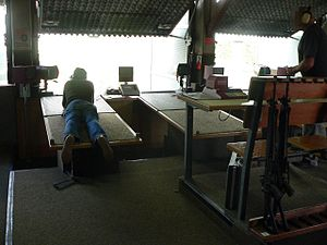 "Gun laws in Switzerland - A ""shooting society"" somewhere in Switzerland; people come to such ranges to complete mandatory training with service arms, or to shoot for sport and competition."