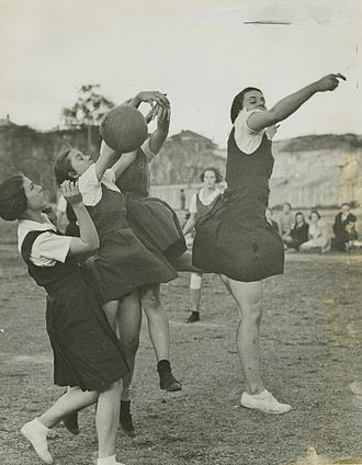 History of netball - Early netball game in Queensland, Australia. The players are wearing gymslips, which were common attire for netballers throughout much of the early 20th century.
