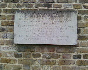 "J & E Hall - The plaque at St Edmund's Burial Ground, East Hill, Dartford. With the words ""Richard Trevithick. Approximately 25ft from this wall lie the remains of Richard Trevithick. The great engineer and pioneer of high-pressure steam. He died at the Bull Inn, Dartford and was carried here by fellow workers of Halls Engineering Works. To a paupers grave. Born Illogan, Cornwall April 13th 1771. Died Dartford, Kent April 22nd 1833""."