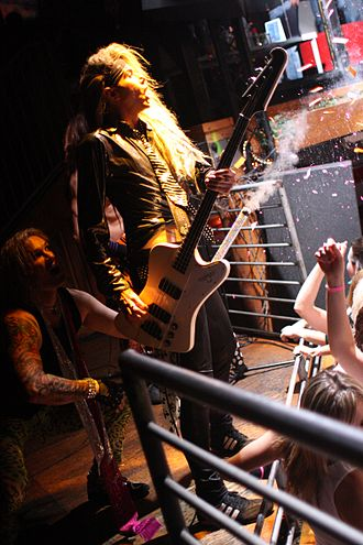 Feel the Steel - Ralph Saenz/Michael Starr (left) and Travis Haley/Lexxi Foxx (center) performing with Steel Panther in San Diego. Photo: Tawny Rockerazzi.