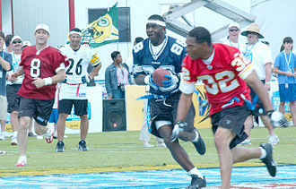Steve Young - Young (8) and Michael Irvin (88) playing in the ESPN Pro Bowl Skills Challenge in 2006