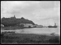 Stewart Island. View of the wharf at Oban, with Presbyterian Church on hill above, the SS Theresa Ward berthed at the wharf, and part of Half Moon Bay. ATLIB 273990.png
