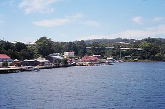 Strahan, Tasmania - A view of Strahan on taken from a boat in Macquarie Harbour