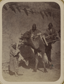 Street Types of Central Asian Cities. Three Men with a Camel WDL11123.png