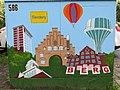 Stromkasten Nr 586, Nordergraben, Mit Flensburg-Motiven Nordetor, Rathaus, Wasserturm, Auguste-Viktoria-Schule sowie eine Maus, Bild 2.JPG