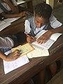 Student on her classwork.jpg