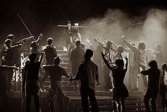 """Metro (musical) - Choreography is an integral part of the musical content. In the picture, """"In God we trust"""" scene"""