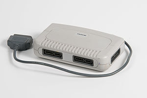 Multitap - An unlicensed multitap for the Super NES.