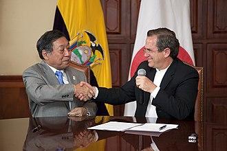 Ecuador–Japan relations - Ecuadorian Foreign Minister Ricardo Patiño and Japanese Ambassador to Ecuador, Toru Kodaki after signing an agreement for Japan to donate audiovisuales to Ecuador; 2013.