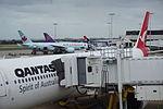 Sydney Airport T1 qantas plane at gate1.JPG
