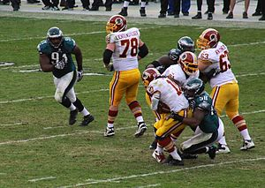 Trent Cole - Cole sacks Redskins quarterback Robert Griffin III during the Eagles' 24-16 victory on November 17, 2013.