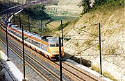 A TGV Sud-Est set in the original orange livery, since superseded by silver and blue.