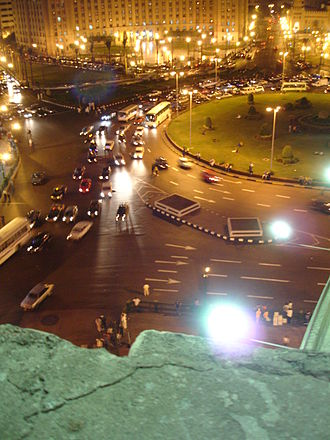Tahrir Square - Tahrir Square at night with traffic circle, view northwest from Talaat Harb Street