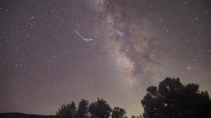 File:Teapot and teaspoon in night sky.webm