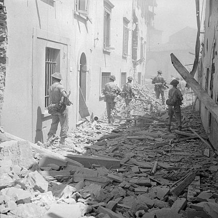 British infantry moving cautiously through the ruined streets of Imprunetta, 3 August 1944 The British Army in Italy 1944 NA17570.jpg