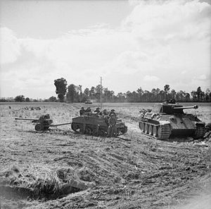70th Infantry Brigade (United Kingdom) - A Loyd carrier and 6-pounder anti-tank gun of the 11th Battalion, DLI parked alongside a knocked-out German Panther tank during Operation 'Epsom', 27 June 1944.