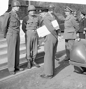 John B. Anderson (general) - British Field Marshal Sir B. L. Montgomery talking with Lieutenant General W. H. Simpson and Major General J. B. Anderson. Behind are General O. N. Bradley and British Field Marshal Sir A. F. Brooke, 25 March 1945.