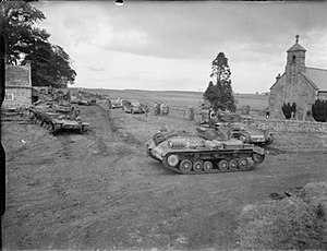 11th Armoured Division (United Kingdom) - Valentine tanks of the 11th Armoured Division gather near a church during an exercise in Northern Command, 16 October 1941.
