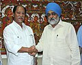 The Chief Minister of Nagaland, Shri Neiphiu Rio meeting the Deputy Chairman, Planning Commission, Shri Montek Singh Ahluwalia to finalize the Annual Plan outlay for 2011-12 of the Nagaland, in New Delhi on May 18, 2011.jpg