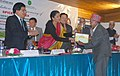 The Minister of State for Commerce & Industry (Independent Charge), Smt. Nirmala Sitharaman presenting the Large Cardamom Productivity award to the winning farmer, in Nacheybong, Gangtok.jpg