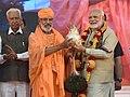 The Prime Minister, Shri Narendra Modi at the Bahubali Mahamasthakabhisheka Mahotsava, at Shravanabelagola, in Karnataka on February 19, 2018. The Governor of Karnataka, Shri Vajubhai Vala is also seen.jpg