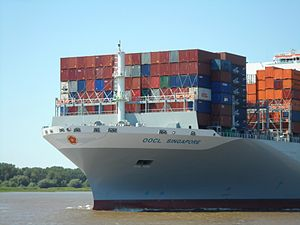 The bow of the new OOCL Singapore heading along the river Elbe towards the Port of Hamburg in July 2014