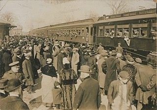 An image from the Picturing Canada collection showing people at a railway station