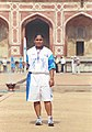 The weightlifter Karnam Malleswari bronze medallist at the Sydney Olympic Games 2000, with the Olympic flame at Humanyun's Tomb during the Olympic Torch Relay 2004 in New Delhi on June 10, 2004.jpg