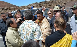 Thirty Meter Telescope - Cultural practitioner Joshua Lanakila Mangauil, along with Kahoʻokahi Kanuha and Hawaiian sovereignty supporters block the access road to Mauna Kea in October 2014, demonstrating against the building of the Thirty Meter Telescope.