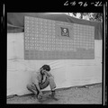 Tired member of VF-17 pauses under squadron scoreboard at Bougainville. - NARA - 520962.tif