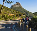 Tourists walking along Table Mountain Road near cableway base station.jpg