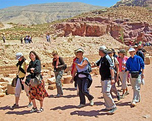 Walking tour - Tourists on a walking tour of the lower canyon at Petra, Jordan