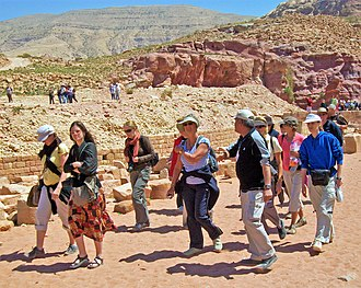 Walking tour - Tourists on a walking tour of the lower canyon at Petra, Jordan
