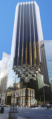 a view upward toward the top of the Trump Tower, a 68-story building with a brown-glassed facade