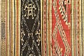 Tubular skirt detail, Thai Den, Son La, 1945, ikat with red and indigo background, woven patterns with extra threads - Vietnamese Women's Museum - Hanoi, Vietnam - DSC03903.JPG