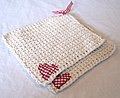 Two white potholders with hearts.jpg