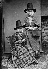 Two women in national dress (Mrs Roberts)