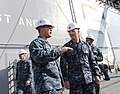 U.S. Navy Senior Chief Aviation Boatswain's Mate (Handling) Marcus Aguirre, left, explains the ship's flight deck layout to Master Chief Petty Officer of the Navy Mike Stevens during a tour of 131211-N-LQ799-225.jpg