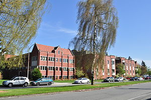 University of Puget Sound - Harned and Thompson Halls, along Union Avenue. Harned Hall is at center, with wings of Thompson Hall on either side.