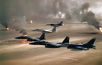 F-15 and F-16 flying over Kuwaiti oil fires during the Gulf War in 1991. USAF F-16A F-15C F-15E Desert Storm edit2.jpg