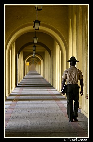 Marine Corps Recruit Depot San Diego - A drill instructor, Gunnery Sergeant, walks the long hallway at the MCRD. The building is listed on the National Register of Historic Places.