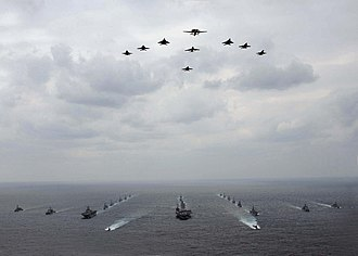 Military organization - A mixed aircraft and ship formation of military vehicles during an exercise with USN and JASDF vehicles.