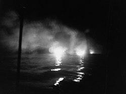 USS Helena (CL-50) firing during the Battle of Kula Gulf, 6 July 1943 (80-G-54553).jpg